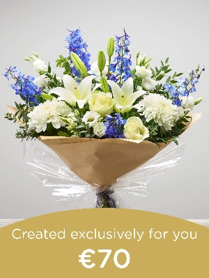 Hand tied bouquet made with seasonal flowers..